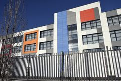 Colorful facade of a modern school building. Moscow area, Russia - November 26, 2016: Building of secondary school in residential complex `Peredelkino Blizhnee stock photos