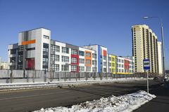 Colorful facade of a modern school building. Moscow area, Russia - November 26, 2016: Building of secondary school in residential complex `Peredelkino Blizhnee stock photo