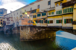 Colorful facade of the Ponte Vecchio on the Arno River royalty free stock image
