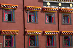 Colorful facade of Tibet, Kham. Facade, window frames and typical decoration of houses in Kham Tibet Royalty Free Stock Photo