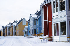 Colorful Facades. A row of colorful swedish buildings in winter Stock Photo