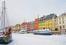 Colorful facades along Nyhavn in Copenhagen of Denmark in winter royalty free stock photography