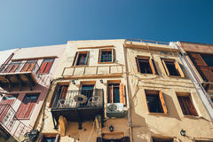 Colorful facades of bulidins in old port in Chania, vintage look Royalty Free Stock Photos