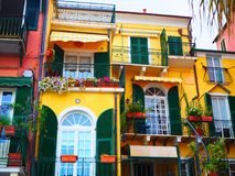 Colorful facades of famous resort  Alassio province of Savona on the Italian Riviera in Western Liguria, Italy. Colorful facades of famous resort  Alassio Royalty Free Stock Photo