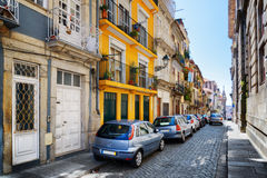 Colorful facades of old houses on the street of Porto, Portugal.  Stock Images