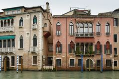 Colorful facades of old medieval and historical houses along Grand Canal in Venice, Italy. Venice is situated across a group of 11 Stock Photography