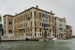Colorful facades of old medieval and historical houses along Grand Canal in Venice, Italy. Venice is situated across a group of 11 Royalty Free Stock Images