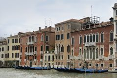 Colorful facades of old medieval and historical houses along Grand Canal in Venice, Italy. Venice is situated across a group of 11 Stock Images
