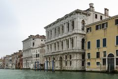 Colorful facades of old medieval and historical houses along Grand Canal in Venice, Italy. Venice is situated across a group of 11 Royalty Free Stock Photography