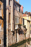 Colorful facades of old medieval houses in Venice Stock Images