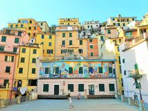 COLORFUL FACADES AND WINDOWS IN RIOMAGGIORE, CINQUE TERRE, ITALY Stock Photos