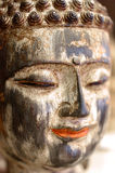 Colorful face of Buddha smiling. Close up portrait of Buddha statue Royalty Free Stock Photos