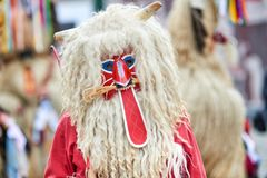 Colorful face of Kurent, Slovenian traditional mask. Traditional mask used in februar for winter persecution, carnival time, Slovenia. Roots draws from the Royalty Free Stock Photo