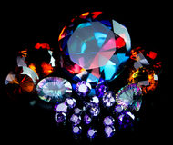 Colorful Faceted Gemstone Collection. Isolated on black background. Includes Madeira Citrines, Amethyst. Rainbow Quartz, and Mystic Topaz Royalty Free Stock Images