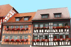 Picturesque fachwerk houses with blooming flowers, Erfurt, Germany. Colorful fachwerk houses with blooming geraniums in Erfurt, Germany, Europe Stock Photography