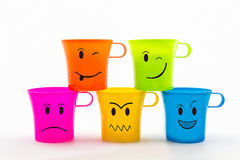 Colorful of facial expression on cup. Royalty Free Stock Images