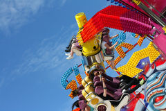 Colorful Fairground Ride. Colorful fast moving Fairground Ride Stock Photo