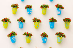 Colorful fake flowers on wall Stock Photography