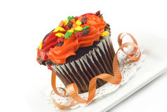 Colorful Fall Cupcake on Plate Royalty Free Stock Photography