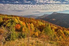 Colorful fall landscape with clouds Stock Image