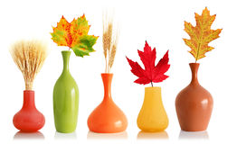 Colorful fall leaves and wheat in vases Stock Photography