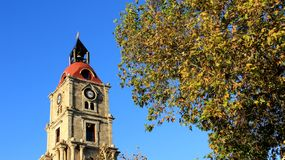 Colorful Falling Leaves With Old Clock Tower royalty free stock images