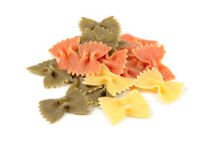 Colorful Farfalle (Bow-Tie) Pasta Isolated on White Background. A pile of colorful uncooked farfalle pasta isolated on a white background royalty free stock photos