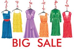 Colorful fashion cocktail dress hang on ribbon. Royalty Free Stock Photos