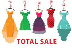 Colorful fashion colored dresses hang on ribbon.Total Sale Stock Images