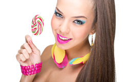 Colorful fashion model with lollipop Stock Images