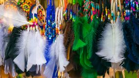 Colorful feathers in the form of a border. With white, green and black color royalty free stock photos