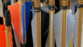 Colorful feathers from set of arrows displayed GH4 4K UHD Stock Image