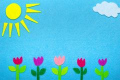Colorful felt background with sun, clouds and tulip flowers,. Copy space Royalty Free Stock Photo