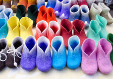 Colorful felt boots in market Stock Photography