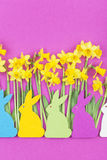 Colorful felt Easter bunnies in front of daffodils Royalty Free Stock Image
