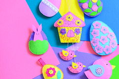 Colorful felt Easter DIY on flat felt sheets. Felt Easter eggs, house with birds, bunny decorations. Funny Easter background Stock Photography