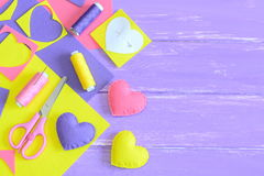 Colorful felt heart decoration set, handicraft supplies on wooden background with copy space for text. Handmade romantic gifts Stock Photography