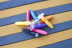 Colorful felt pens as striped texture background. Colorful felt pens for painting glass as striped texture background Stock Photos