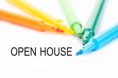 Colorful felt-tip pen and open house word on white background.  stock photo