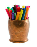 Colorful felt tip pens retro copper bowl isolated. Closeup of motley colorful felt-tip felt tip pens in copper bowl isolated on white background Stock Photo