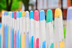 Colorful fence on the playground stock images