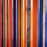 Colorful fence. Repeated wooden blocks. Aged photo Stock Image