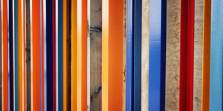 Colorful fence. Repeated wooden blocks. Aged photo Stock Photography