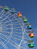 Colorful ferris wheel. Colorful gondola carriage on ferris wheel with blue sky background Stock Photos