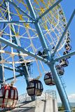 Ferris wheel with colorful cabins royalty free stock photography