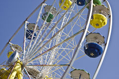 Colorful Ferris wheel in blue sky Stock Image