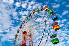 Colorful Ferris Wheel with blue sky on the background Royalty Free Stock Photos