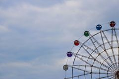 Colorful ferris wheel on blue sky background. stock photos