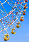 Colorful ferris wheel on blue sky background Stock Photo