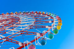 Colorful Ferris Wheel in blue sky Royalty Free Stock Images